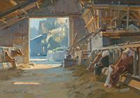 Cows in sunlit barn